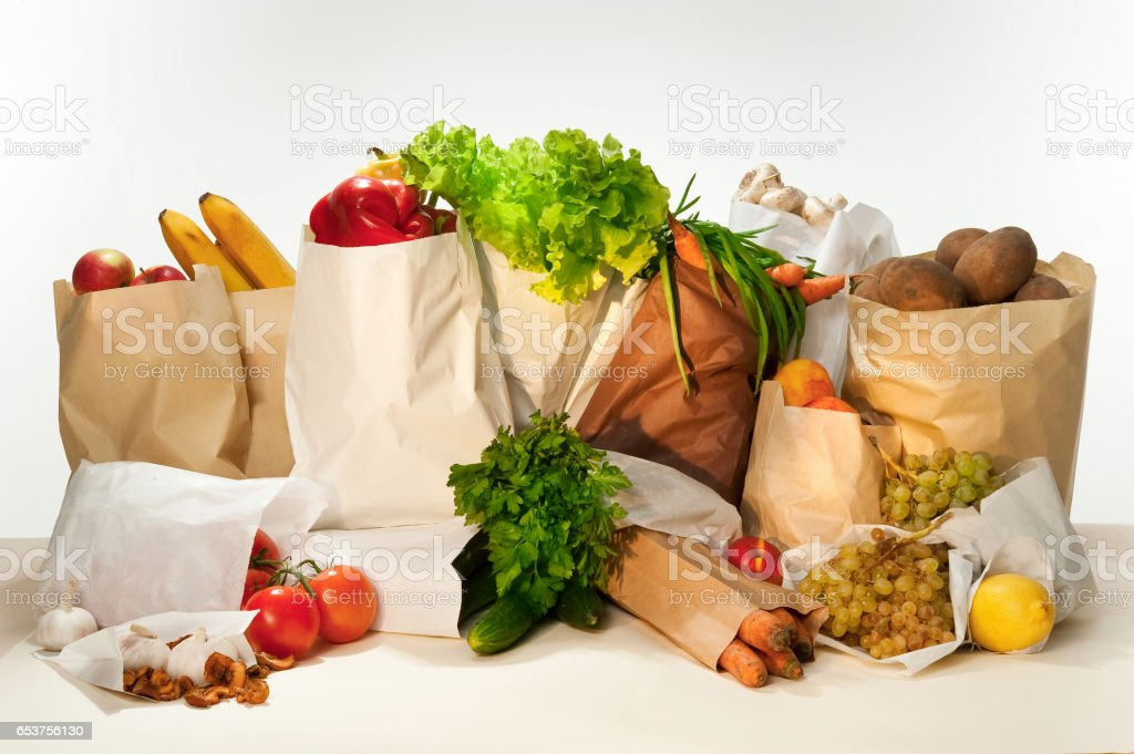 Healthy eating. Fresh vegetables and fruits in paper bags. stock photo