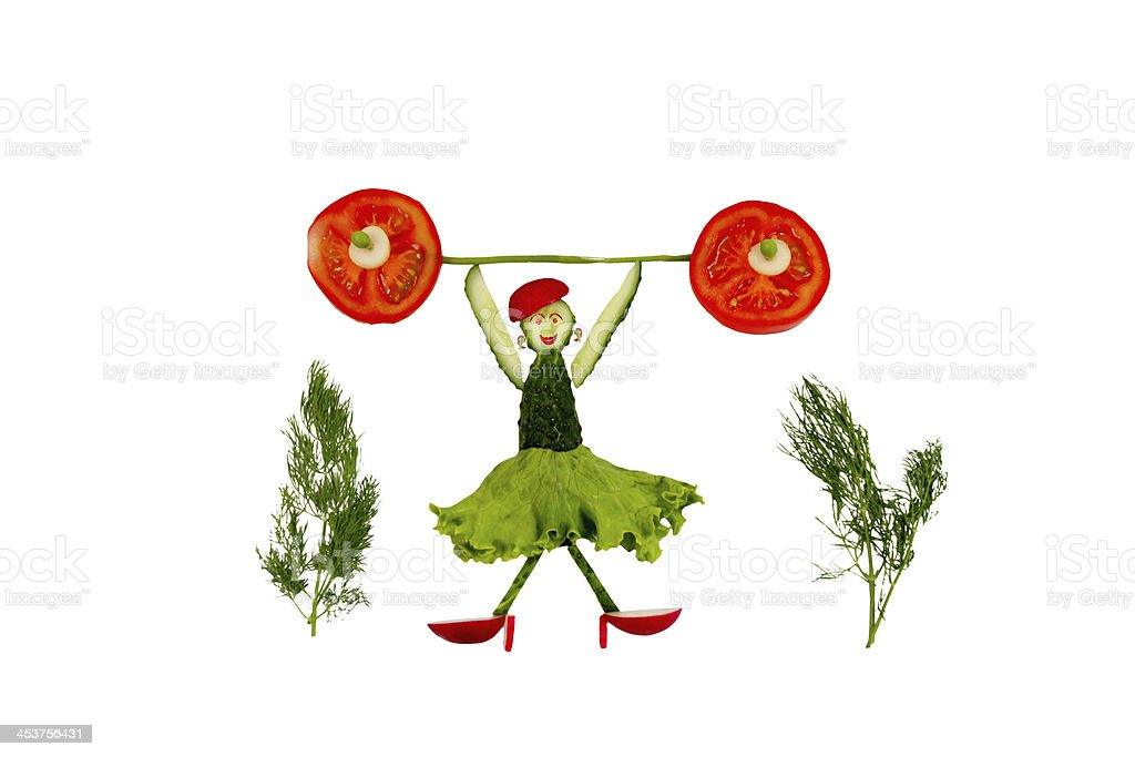 Healthy eating. Funny little woman of the cucumber slices royalty-free stock photo