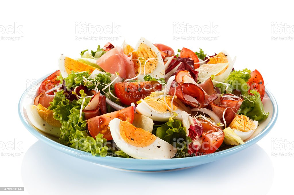 Healthy eating - ham, boiled eggs and vegetables stock photo