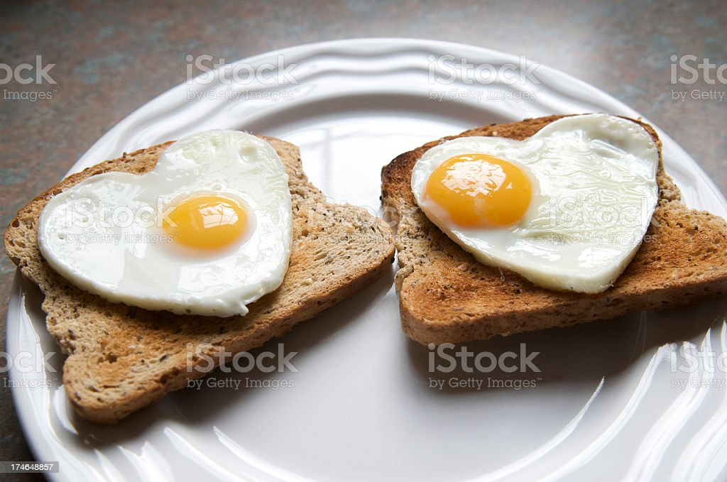 Healthy Eating Heart Shape Big Yolk Egg on Toast royalty-free stock photo