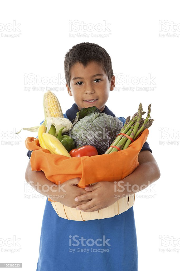 Healthy Eating: Hispanic Little Boy Holding Basket Vegetables Waist Up royalty-free stock photo