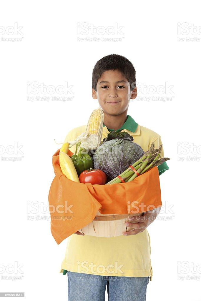 Healthy Eating: Hispanic Little Boy Holding Basket Vegetables Waist Up royalty-free stock photo