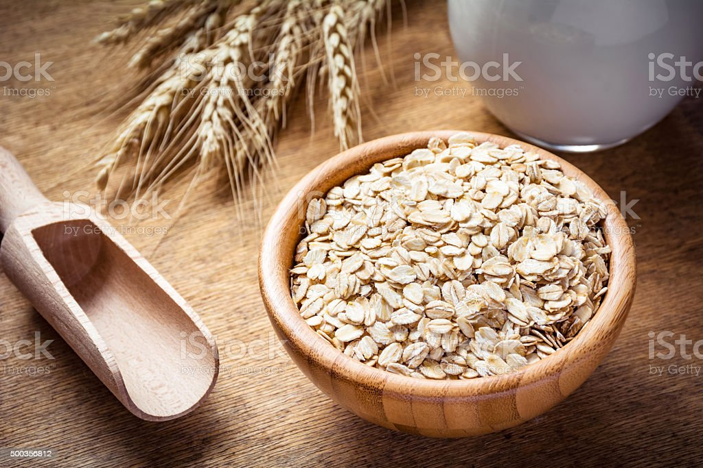 Healthy eating: oats and milk stock photo
