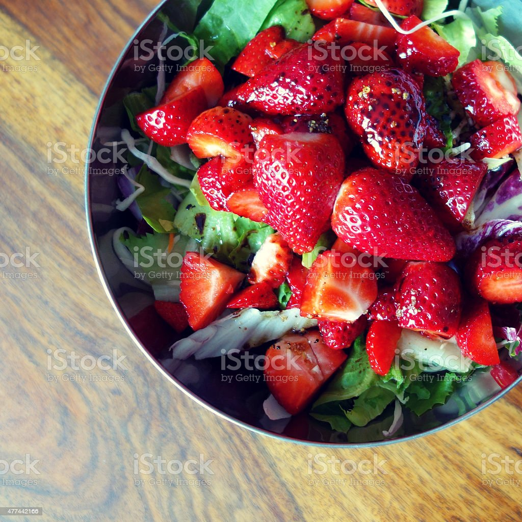 Healthy eating - salad with strawberries stock photo