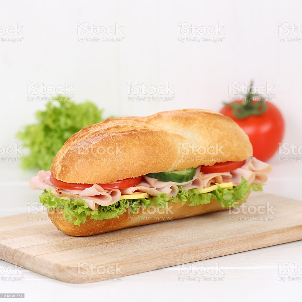 Healthy eating sub deli sandwich baguette with ham for breakfast stock photo