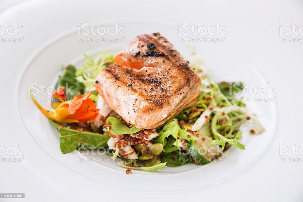 Healthy eating with grilled salmon stock photo