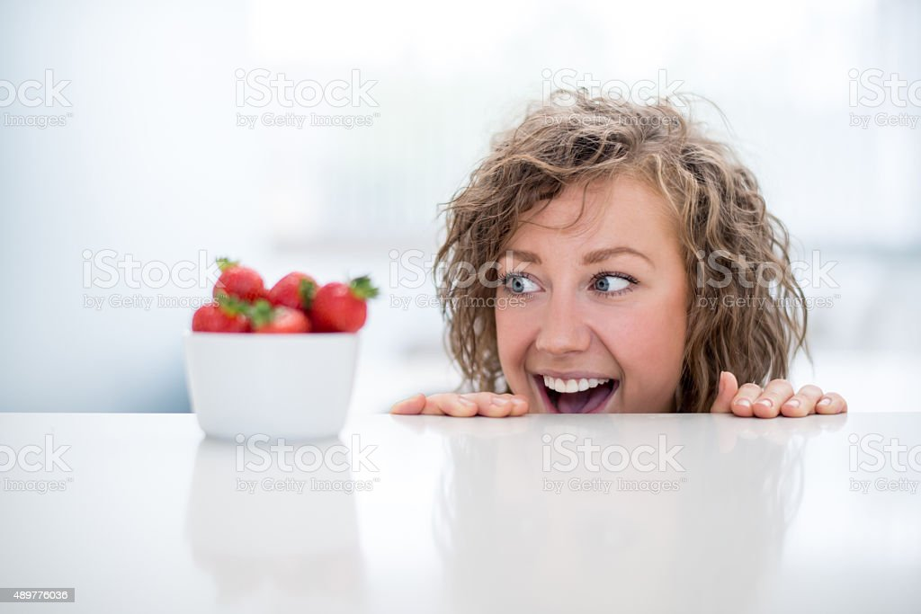 Healthy eating woman craving for strawberries stock photo