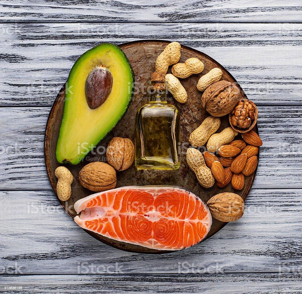 Healthy fat salmon, avocado, oil, nuts stock photo