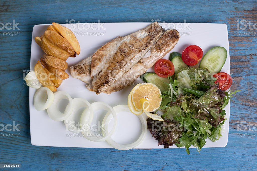 Healthy Fish Dinner-Grilled Sea Bass stock photo