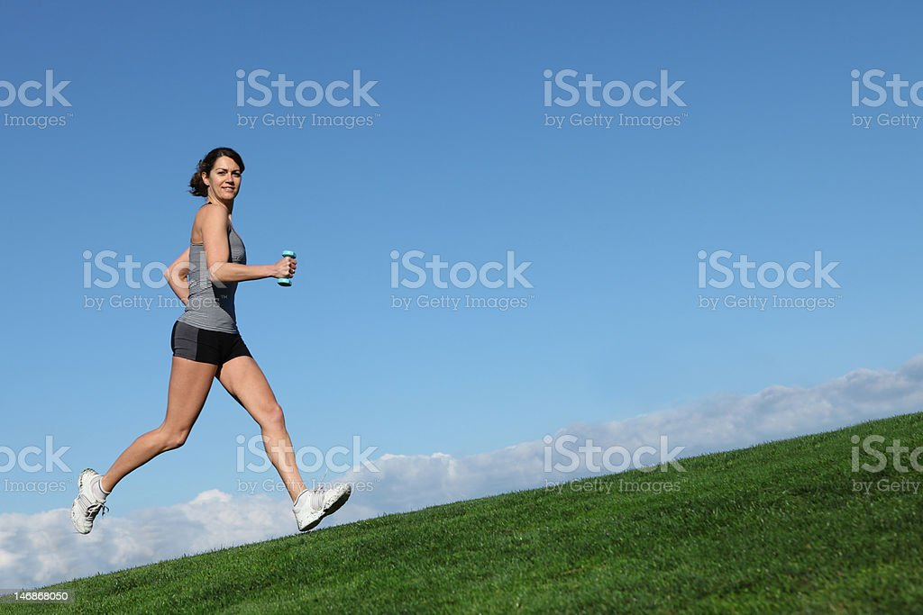 healthy fit woman jogging or running outdoors stock photo