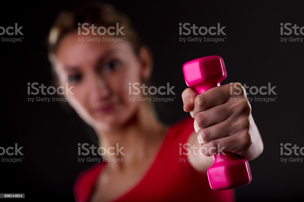 Healthy fit woman working out with weights stock photo