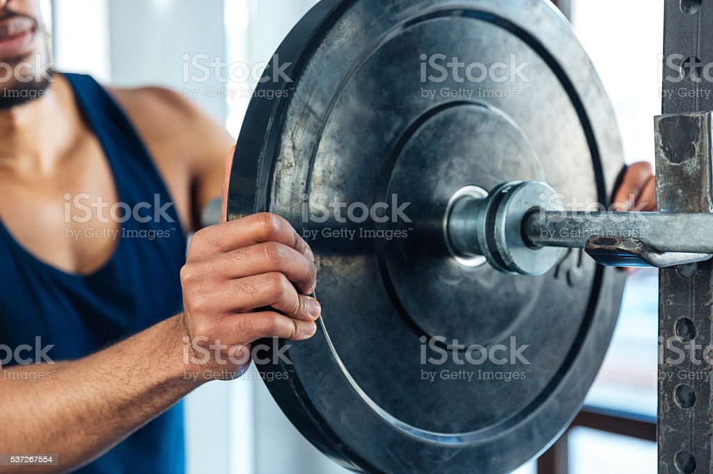Healthy fitness guy prepare to do exercises with barbell stock photo