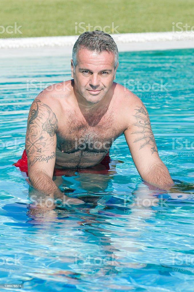 Healthy fitness man doing aqua bike in swimming pool royalty-free stock photo