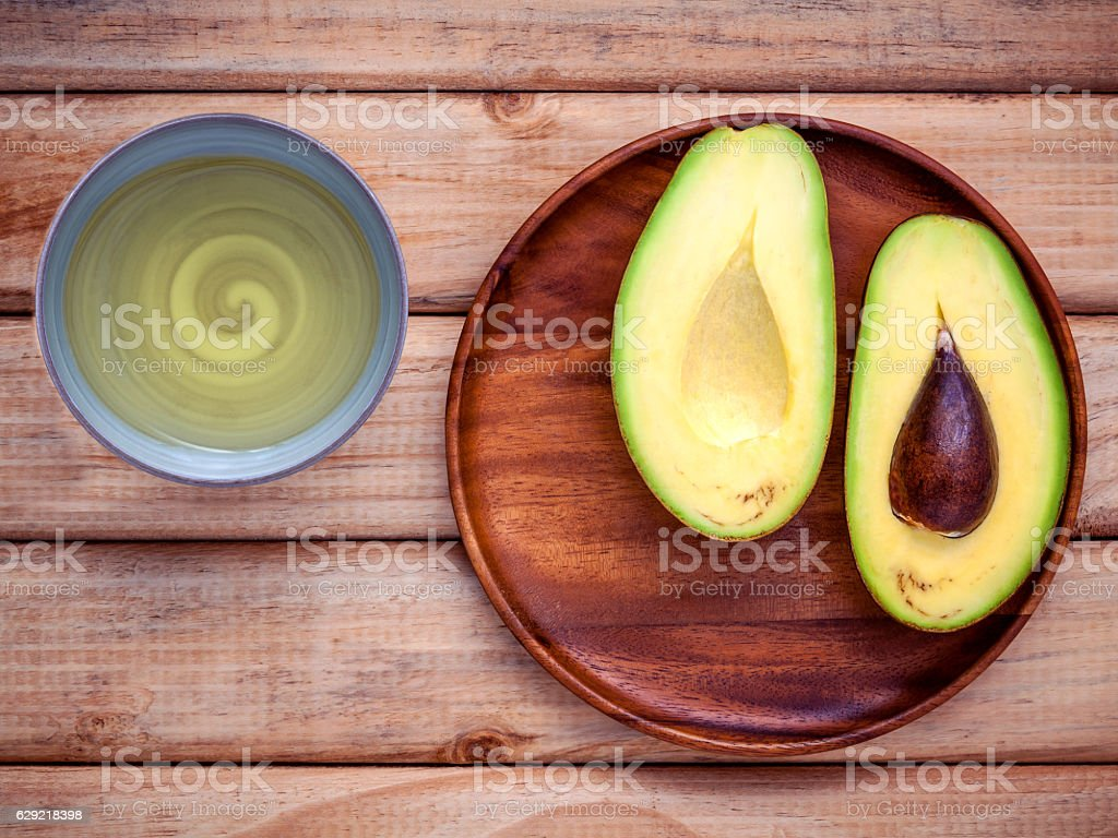Healthy food concept. Fresh avocado in wooden plate on shabby stock photo