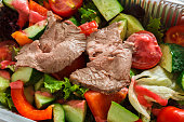 Healthy food in boxes, diet concept. Steamed beef with vegetables