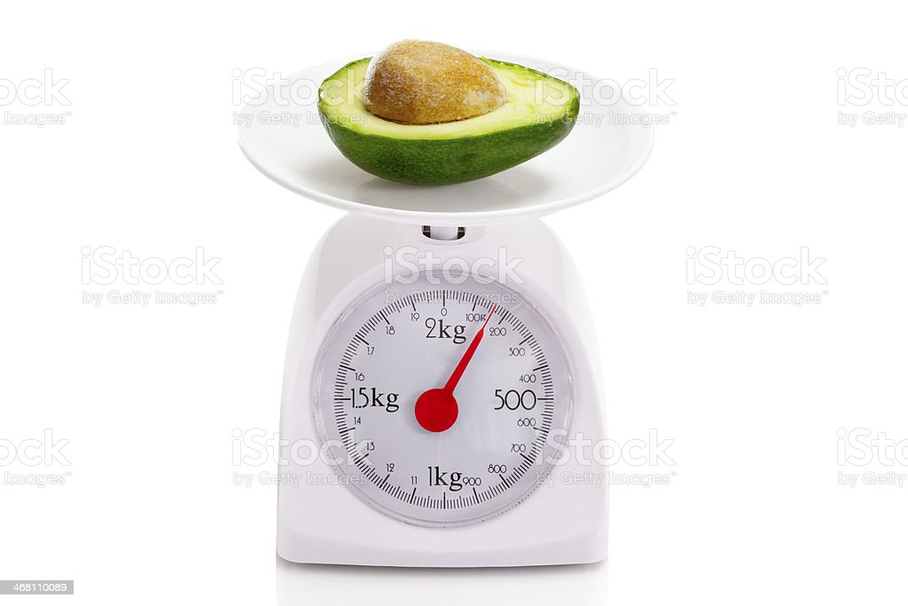 Healthy food on balance scale royalty-free stock photo
