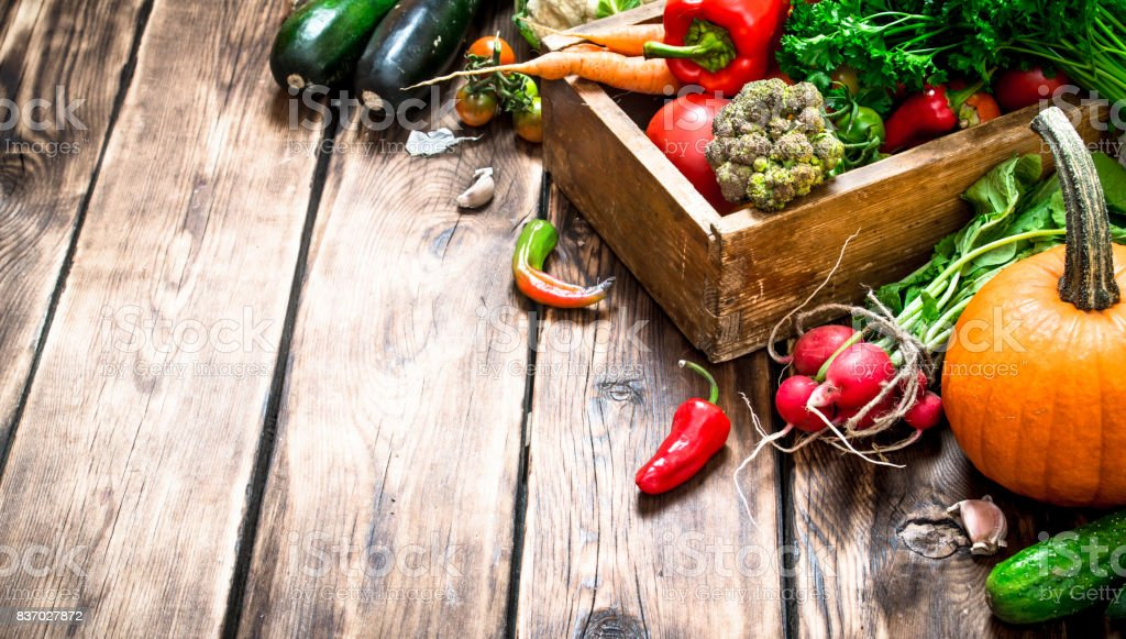 Healthy food. Organic vegetables in an old box. stock photo