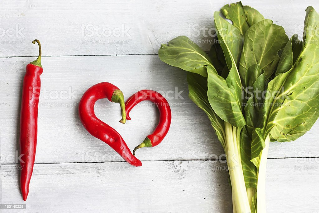 Healthy food pictured with chilies shaped into a heart stock photo
