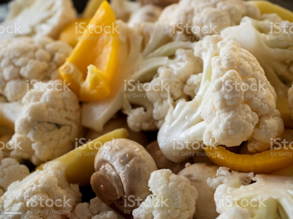 Healthy food: raw cauliflower, mushrooms and yellow bell pepper. Shallow depth of field. stock photo