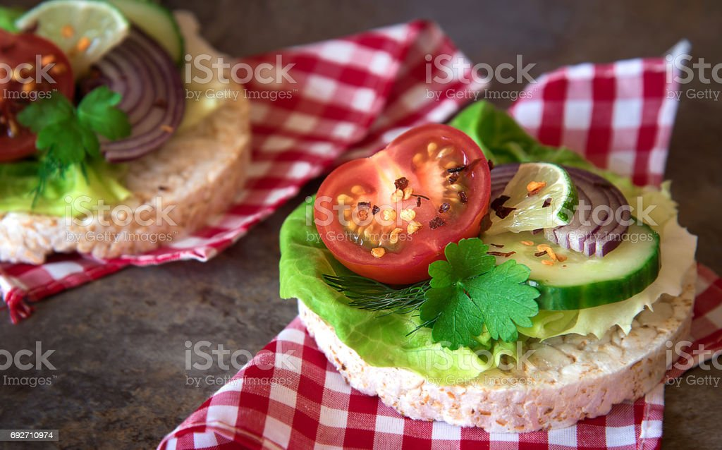 Healthy food - sandwiches, rice cakes with lettuce, tomato, cucumber, onion and parsley stock photo