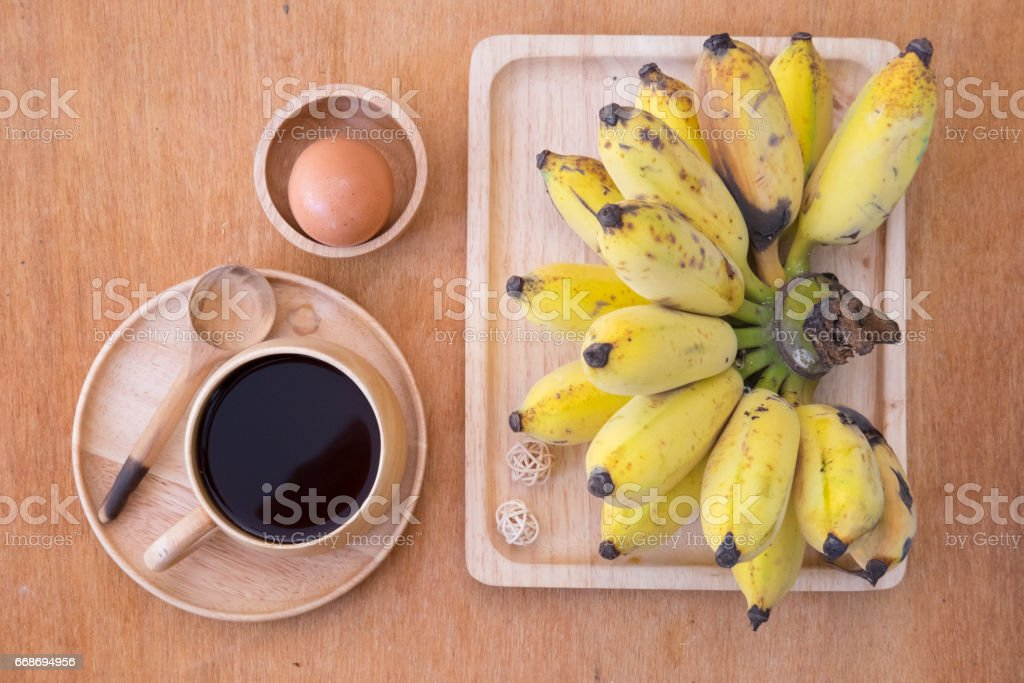 Healthy food set or healthy breakfast  - black coffee, boiled egg and fresh banana stock photo