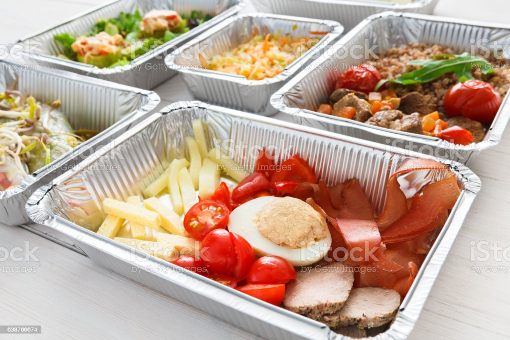 Healthy food take away in foil boxes, meat and vegetables stock photo