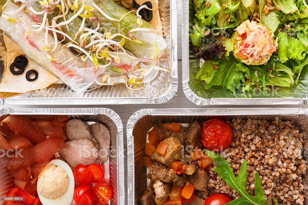 Healthy food take away, top view at wood background stock photo