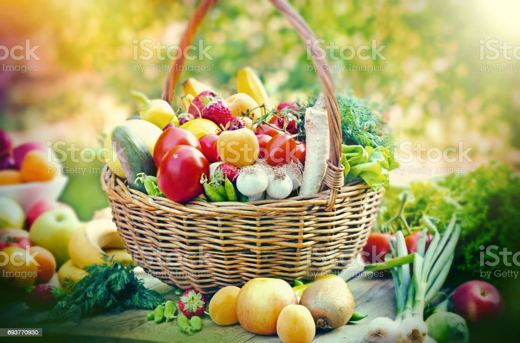 Healthy food - vegetarian food in wicker basket and on table stock photo