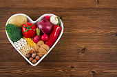 Healthy Foods in Heart Shaped Bowl on Wooden Table