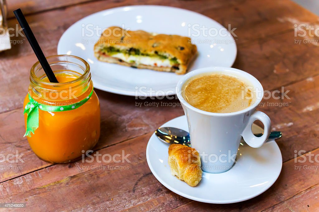 Healthy freakfast of coffee, vitamin C juice and vegetal snack stock photo