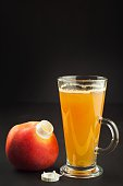 Healthy fresh apple juice drink on wooden background.