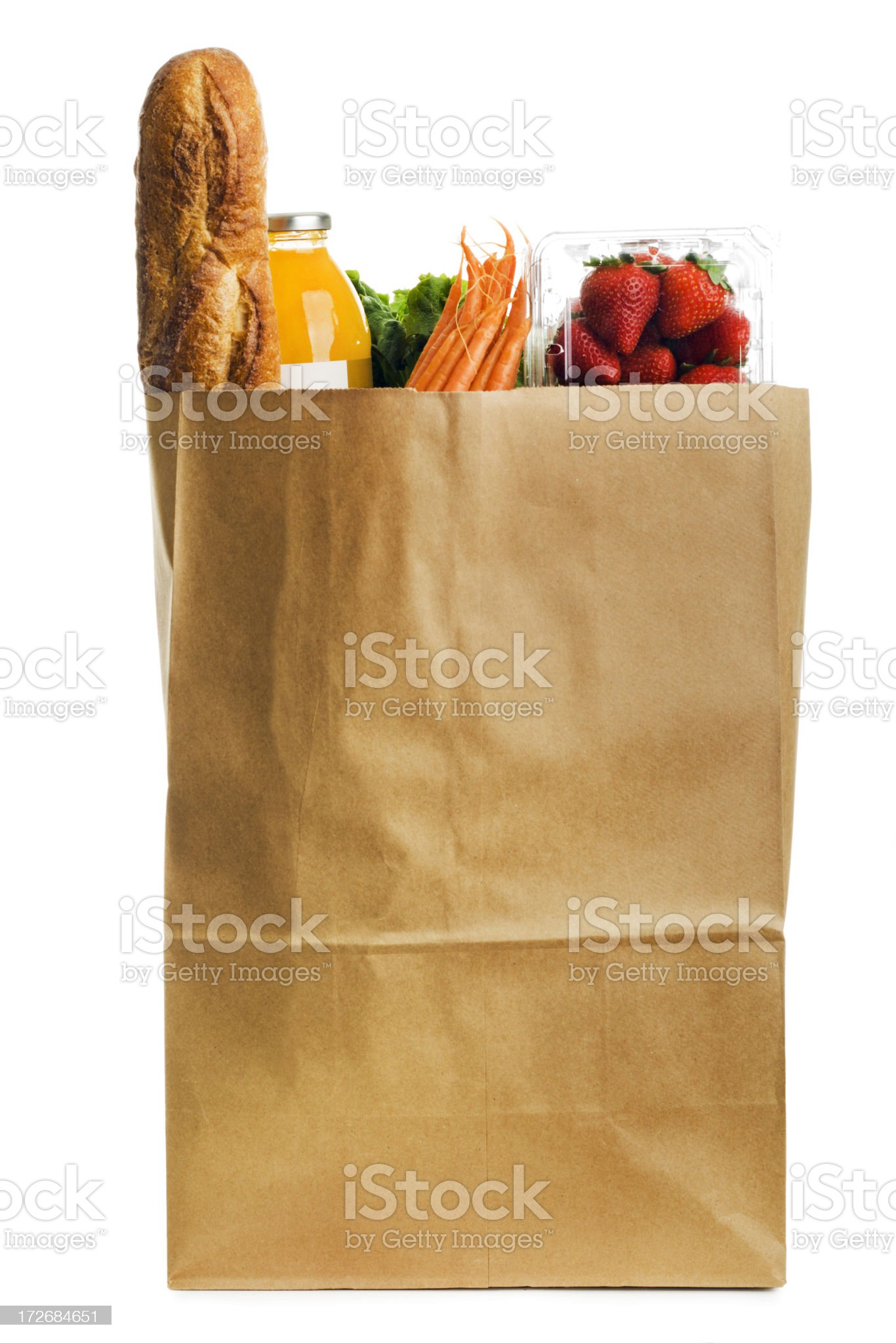 Healthy, Fresh Food in Paper Grocery Bag on White Background royalty-free stock photo