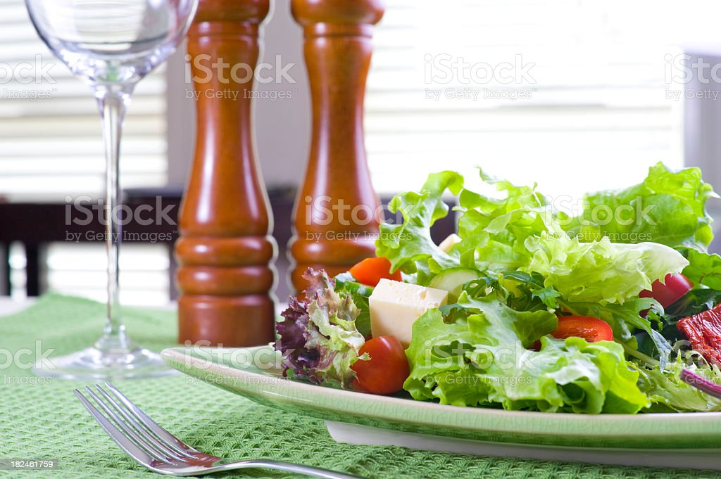 Healthy fresh garden salad on a table stock photo