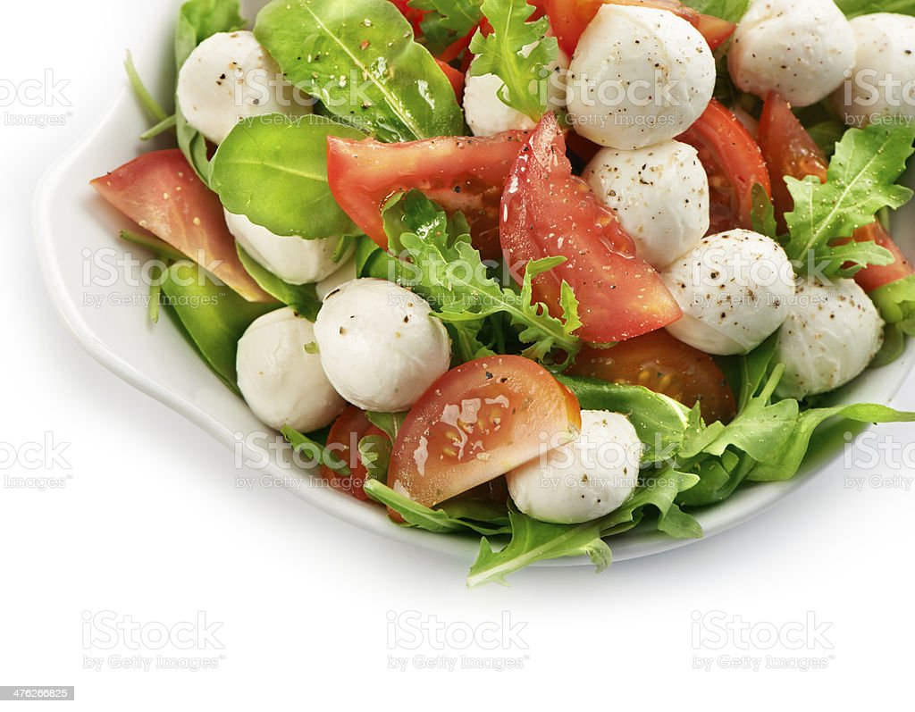 healthy fresh rucola salad with mozarella and tomato slices royalty-free stock photo