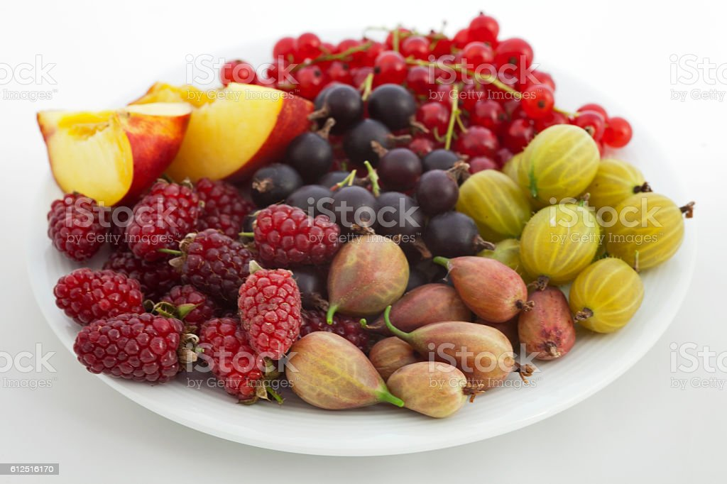 Healthy fruit snacks on a white plate stock photo
