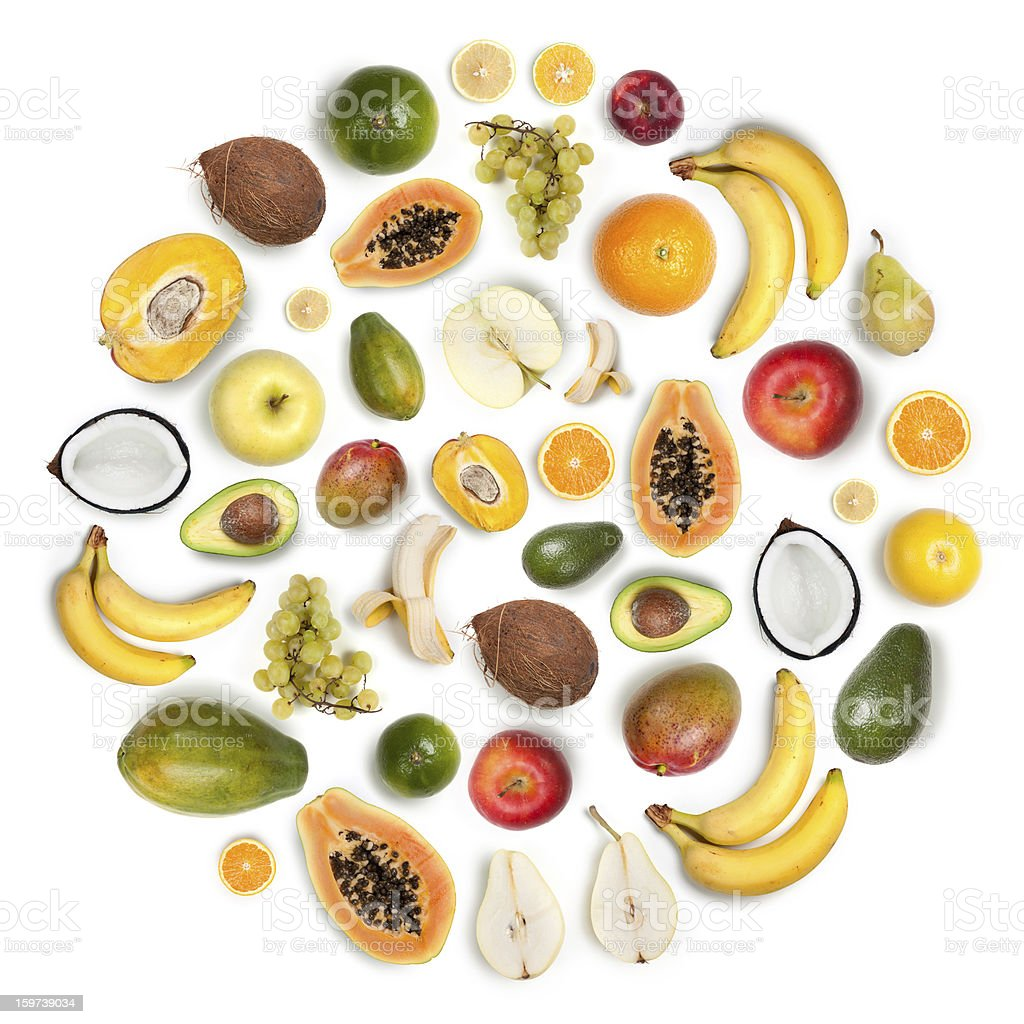 Healthy fruits arranged in a round composition on white background stock photo