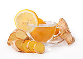 Healthy ginger tea with lemon in a glass cup