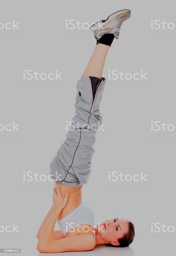 Healthy girl doing a yoga pose royalty-free stock photo