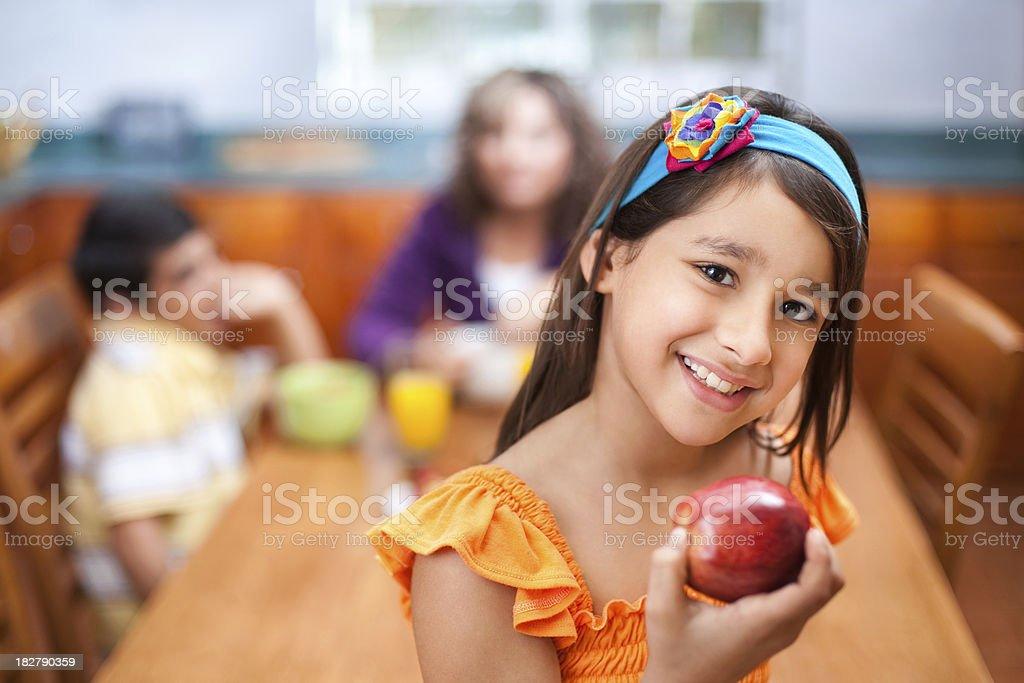 Healthy girl holding an apple stock photo