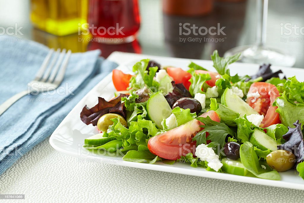 Healthy Greek salad with olives, feta on table for a meal stock photo