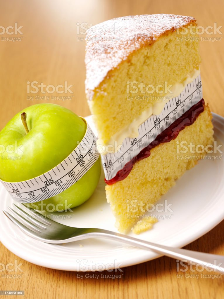 Healthy Green Apple, Calories in a Sponge Cake stock photo