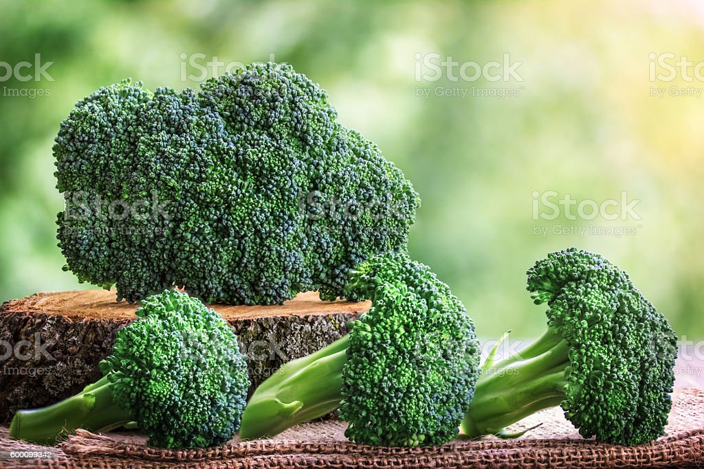 Healthy Green Organic Raw Broccoli Florets Ready for Cooking stock photo