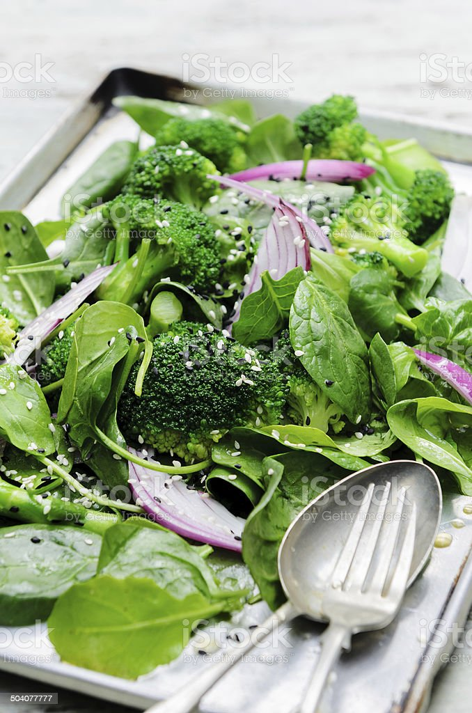 Healthy green salad with seeds and broccoli stock photo