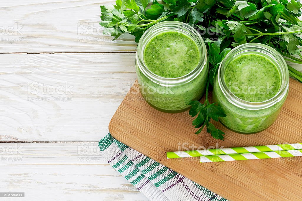 Healthy green smoothie with parsley stock photo