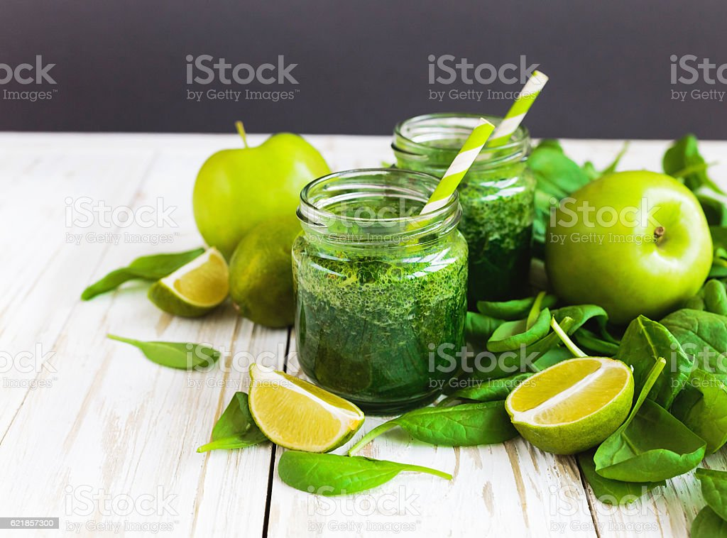 Healthy green smoothie with spinach, lime and apple stock photo