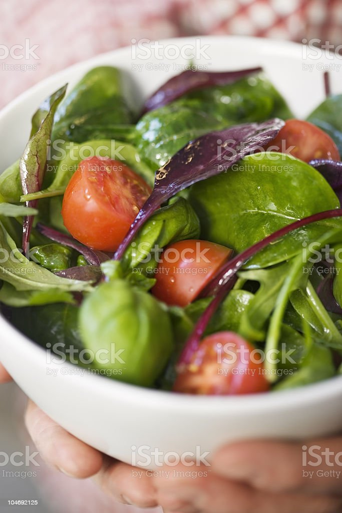 Healthy green Spring mix salad with cherry tomatoes royalty-free stock photo