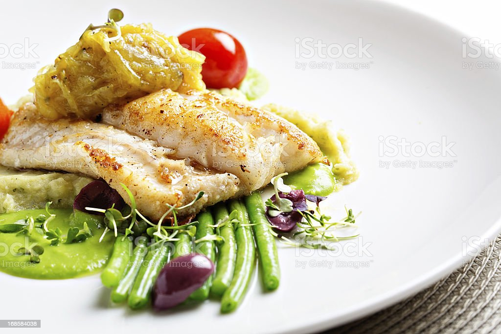 Healthy grilled fish entree with selection of vegetables stock photo