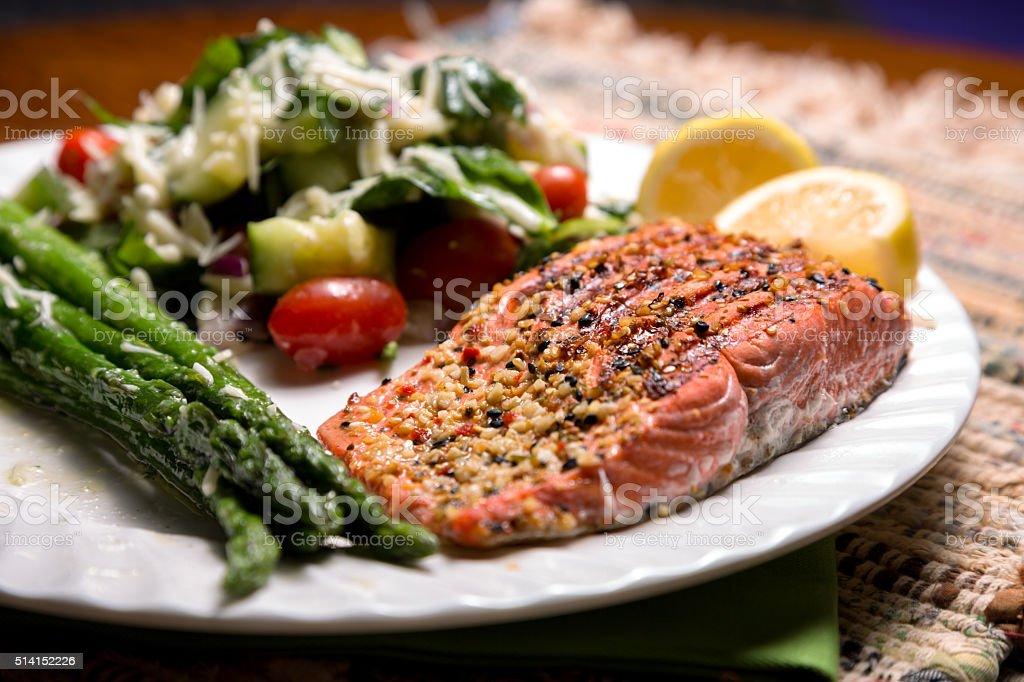 Healthy Grilled Salmon Dinner with Asparagus and Salad stock photo