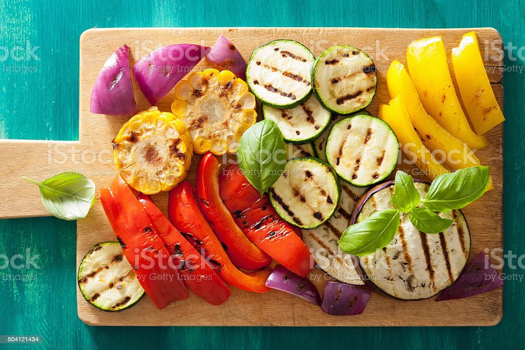 healthy grilled vegetables on chopping board stock photo