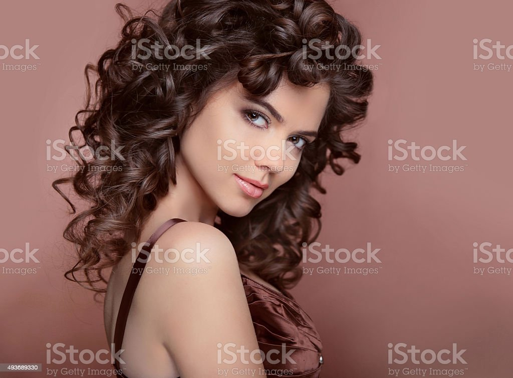Healthy hair. Beautiful young smiling woman with long curly hair stock photo
